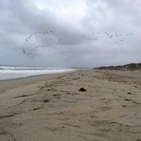 Photo taken at Zmudowski State Beach by Alex S. on 10/9/2013