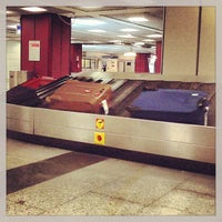 Photo taken at Ritiro Bagagli / Baggage Claim by Marina C. C. on 8/22/2013