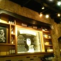 Photo taken at Romano's Macaroni Grill by Rafael M. on 2/8/2014
