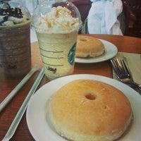 Photo taken at Starbucks Coffee by Ariane B. on 7/17/2013