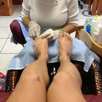 Photo taken at Famous Nails by Nancy S. on 2/22/2013