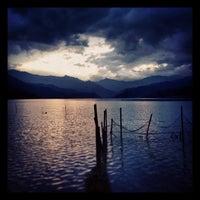 Photo taken at Phewa Tal / Fewa Lake by Aşkın E. on 5/27/2013