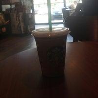 Photo taken at Starbucks by jonathan l. on 10/28/2012
