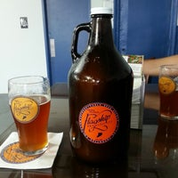 Photo taken at Flagship Brewing Co. by jonathan l. on 6/8/2014