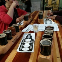 Photo taken at Rogue Ales Public House & Brewery by Mike on 2/28/2013