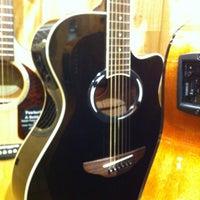 Photo taken at Guitar Center by Robert T. on 1/19/2014