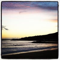Photo taken at Praia dos Amigos by Laurent V. on 12/27/2013