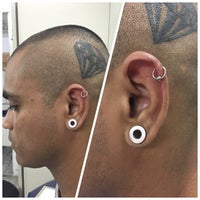 Photo taken at Simple Tattoo Piercing by Leandro R. on 1/3/2015