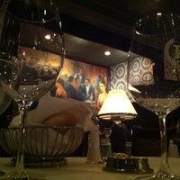 Photo taken at Delmonico's by mc s. on 12/1/2012