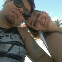 Photo taken at Praia by Mayra C. on 11/10/2013