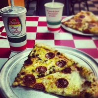 Photo taken at Carmine's Pizzeria by Michael K. on 3/17/2013