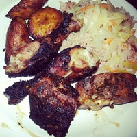 Photo taken at MoBay Caribbean Restaurant Bar & Grill by Brandon S. on 11/22/2013