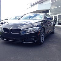 Photo taken at Tom Bush BMW Jacksonville by Marcelo S. on 10/1/2013