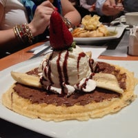 Photo taken at Crepes & Waffles by Alejandro R. on 4/13/2013