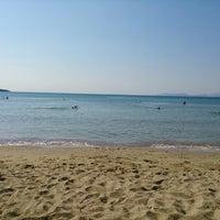 Photo taken at Παραλία Δελφίνι by Nikos G. on 9/1/2013