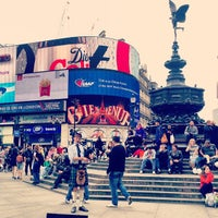 Photo taken at Piccadilly Circus by Natasha R. on 5/12/2013