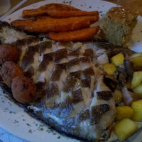 Photo taken at Roastfish & Cornbread by Liz C. on 10/17/2011