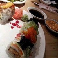 Photo taken at Sushi Zushi by Garrett B. on 12/28/2011