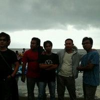 Photo taken at Pantai Pakis Jaya by Budi S. on 12/25/2011