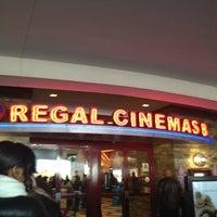 Photo taken at Regal Cinemas Atlas Park 8 by Marie S. on 12/26/2011