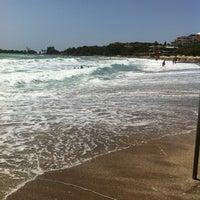 Photo taken at Vouliagmeni Beach by Pavlos V. on 5/23/2013