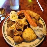 Photo taken at Dragon City Buffet by Ken L. on 12/31/2012