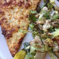 Photo taken at Mezza Luna Pizzeria by Elysia G. on 6/10/2014