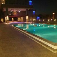Photo taken at Divan Pool by Serkan E. on 6/22/2014