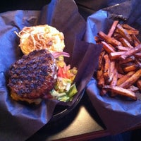 Photo taken at Woody's Burgers bar and grill by Mark M. on 4/6/2013