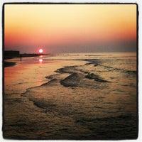Photo taken at 13th St. Beach by Josh K. on 7/17/2013