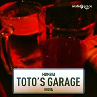 Photo taken at Toto's Garage by Megha G. on 1/18/2013