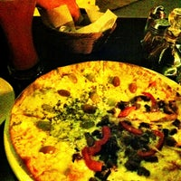 Photo taken at La Lula Restaurante by Ricardo D. on 5/12/2013