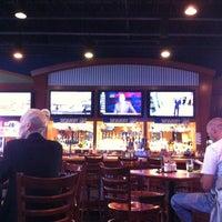 Photo taken at Boston's Restaurant & Sports Bar by Jim S. on 5/23/2013
