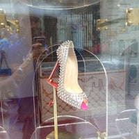 Photo taken at Christian Louboutin by Tony M. on 7/24/2013