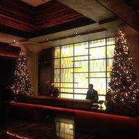 Photo taken at Kimpton Ink48 Hotel by Eric S. on 12/14/2012