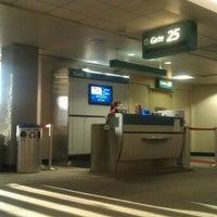 Photo taken at Gate 25 by Saya G. on 9/29/2012