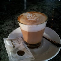Photo taken at Cappuccino Paseo Maritimo by Alberto P. on 10/12/2012