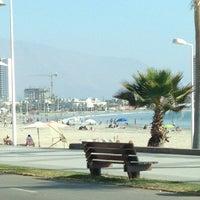 Photo taken at Playa Cavancha by Negrita S. on 3/19/2013
