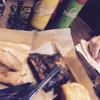 Photo taken at VooDoo BBQ & Grill by Mary M. on 12/10/2014