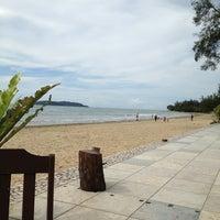 Photo taken at Tanjung Aru 1st Beach by Nis H. on 1/5/2013