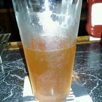 Photo taken at Courthouse Bar and Grille by Susan W. on 7/13/2013