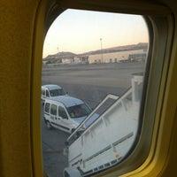 Photo taken at Gate A30 by Mariu on 1/5/2014