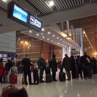 Photo taken at Gate E23 by Henry Y. on 1/22/2014