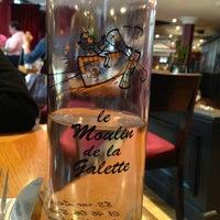Photo taken at Le Moulin de la Galette by Daria S. on 6/10/2013