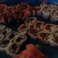 Photo taken at Koko Sushi Bar & Lounge by Benjamin G. on 4/25/2014