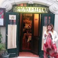 Photo taken at Dragão de Alfama by Esra O. on 4/19/2014