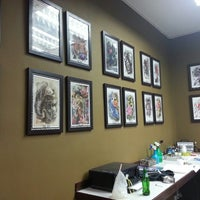 Photo taken at Nam Tattoos Studio by Yuri B. on 3/12/2014