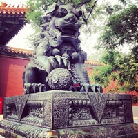 Photo taken at Yonghegong Lama Temple by Lesia F. on 6/14/2013