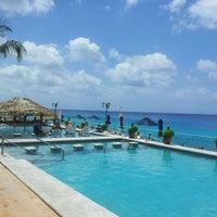 Photo taken at Coral Princess Golf & Dive Resort by Fabiana M. on 3/19/2013