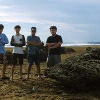 Photo taken at Pantai Ujung Genteng by Rezky K. on 6/12/2013